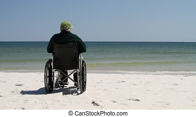 Man Wheelchair Beach - Lonely physically impaired senior...