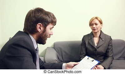 man will interview business woman. report to the Chief