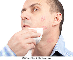 Man wiping lips traces from his face - Portrait of a young...