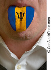 man wit open mouth spreading tongue colored in barbados flag...