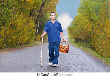Man with a basket of mushrooms