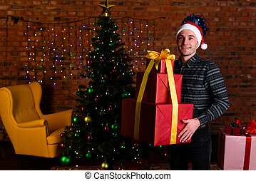 Man with a big red Christmas gift