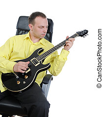 man with a black guitar.