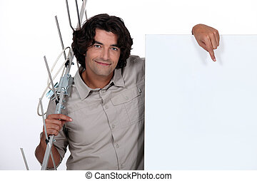 Man with a blank poster and an antenna