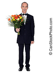 Man with a bouquet of flowers