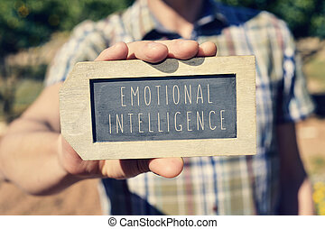 man with a chalkboard with the text emotional intelligence...