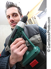 Man with a cordless drill