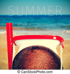 man with a diving mask and the word summer