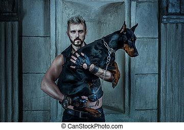 Man with a dog Doberman.
