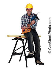 Man with a drill and workbench