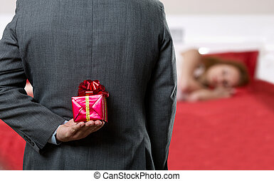 Man with a gift behind his back