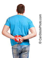 Man with a gift in hand. View from the back.