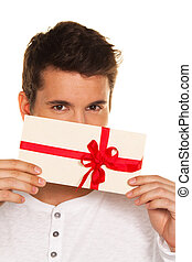 Man with a gift voucher in hand