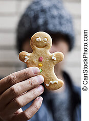 man with a gingerbread man cookie