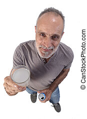man with a glass of lemon soda on white background