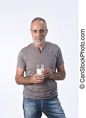man with a glass of milk on white background