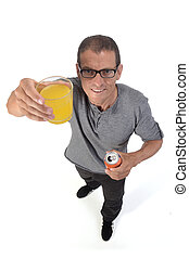 man with a glass of orange soda on white background
