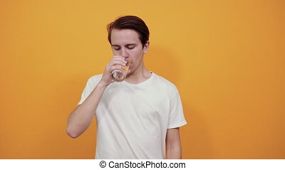 man with a glass of water in his hand.