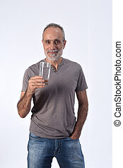 man with a glass water on white background