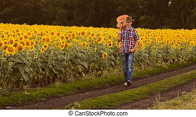 Man with a guitar in sunflowers.