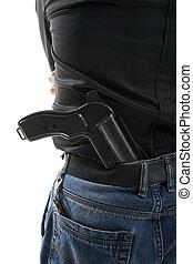 Man with a gun behind his back