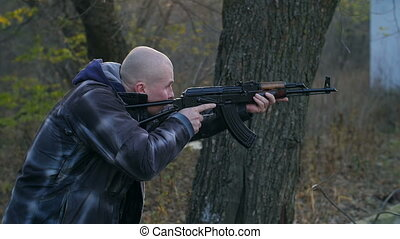 Man with a gun in a forest