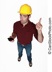 Man with a hardhat with bad news.