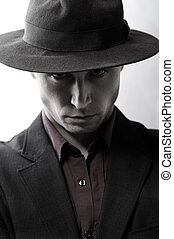 Man with a hat looking at camera