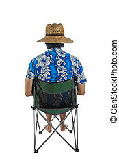 Man with a hat, sitting on a chair.