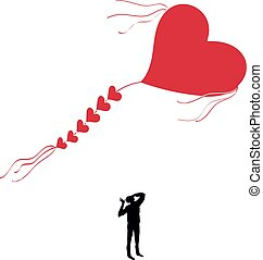 Man with a kite in the shape of heart