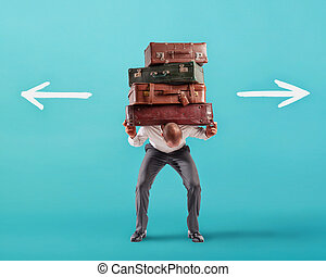 Man with a lot of luggages is confused about the right destination