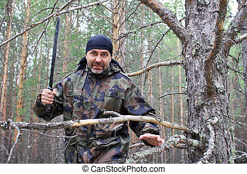 Man with a machete in the forest