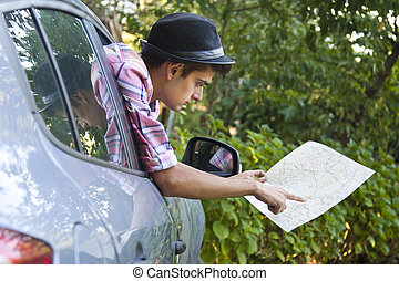 man with a map in the car
