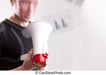 man with a mask watching a megaphone