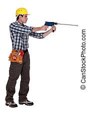 Man with a masonry drill