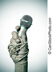 man with a microphone tied with rope - closeup of a...