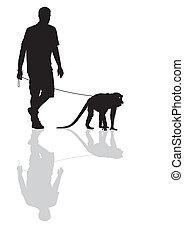 Man with a monkey on a leash