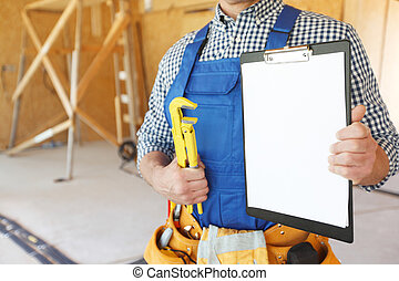 Man with a monkey wrench - Worker with a monkey wrench and ...
