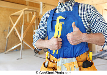 Man with a monkey wrench - Worker with a monkey wrench at ...