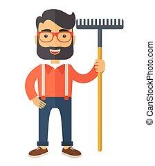 Man with a mustache holding rake. - A caucasian man standing...