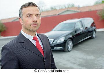 man with a nice car