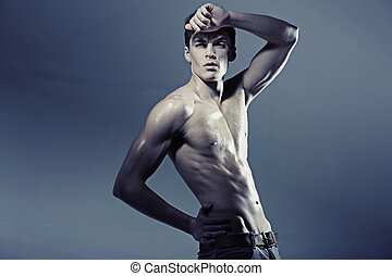 Man with a perfect muscle body - Young man with a perfect...