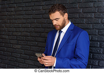 man with a phone standing