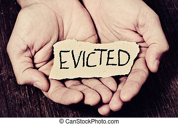 man with a piece of paper with the word evicted