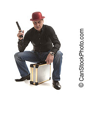 Man with a pistol sitting on the case