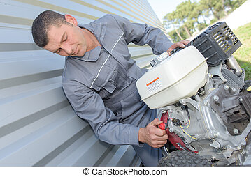 man with a portable motor