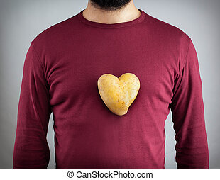 Man with a potato shaped heart on his chest. - Young man...