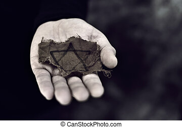 man with a ragged Jewish badge - closeup of a ragged Jewish...