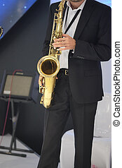 man with a saxophone - image of man with a saxophone
