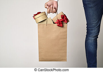 man with a shopping bag full of gifts